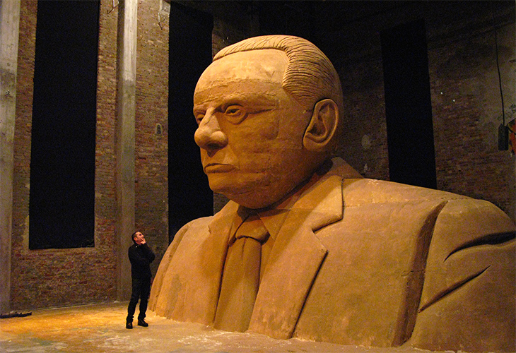 a_person_looking_at_a_sculpture